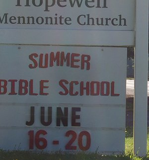 Hopewell Mennonite Church sign announcing Summer Bible School